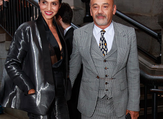 Christian Louboutin attends New York Fashion Week in a three piece suit